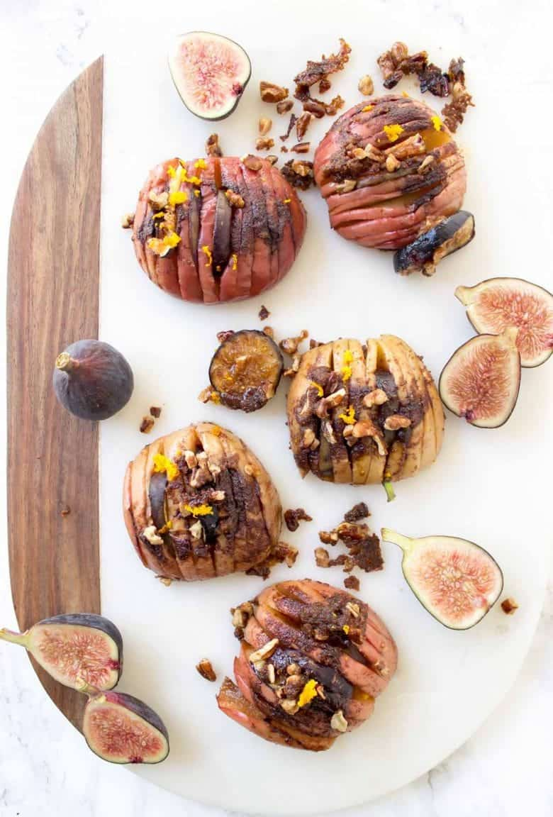 Hasselback Baked Apples with Figs + Pecans - This dairy free, vegan, gluten free, and paleo recipe is falls most perfect dessert.