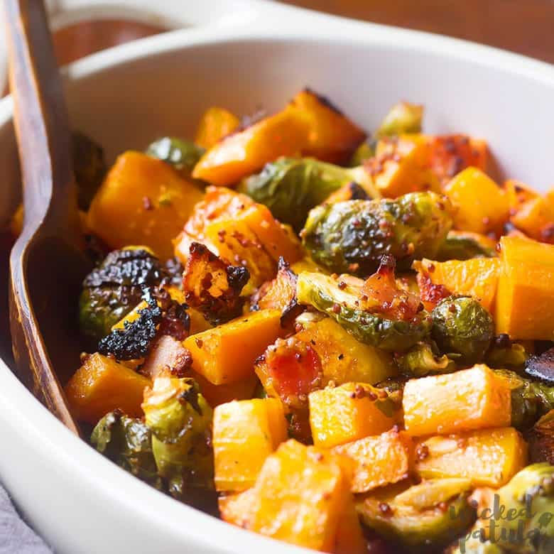 butternut squash and brussels sprouts in a serving dish