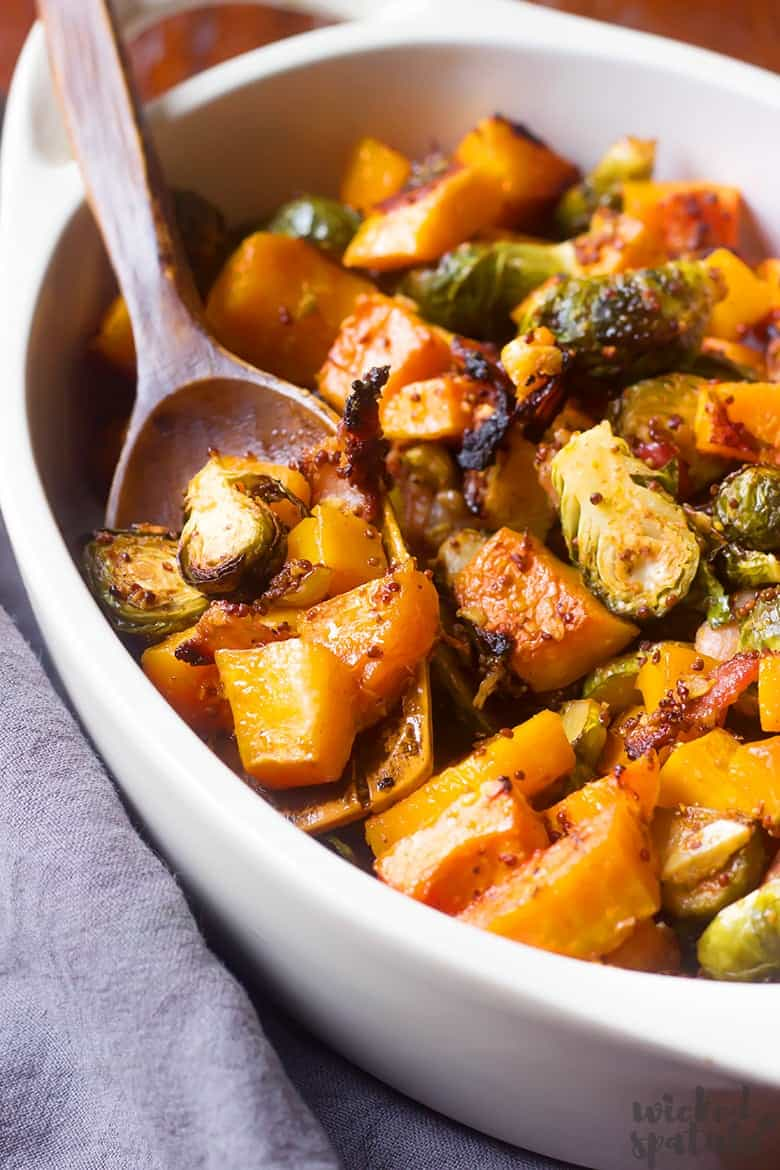 roasted butternut squash and brussels sprouts in a serving dish