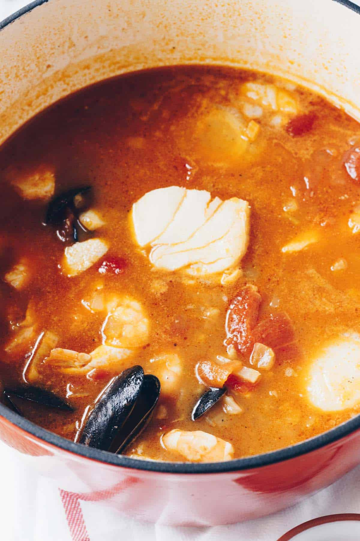 This Mixed Seafood Stew is ready in just 30 minutes and is packed with scallops, shrimp, cod, and mussels! This is one nutrient packed soup!