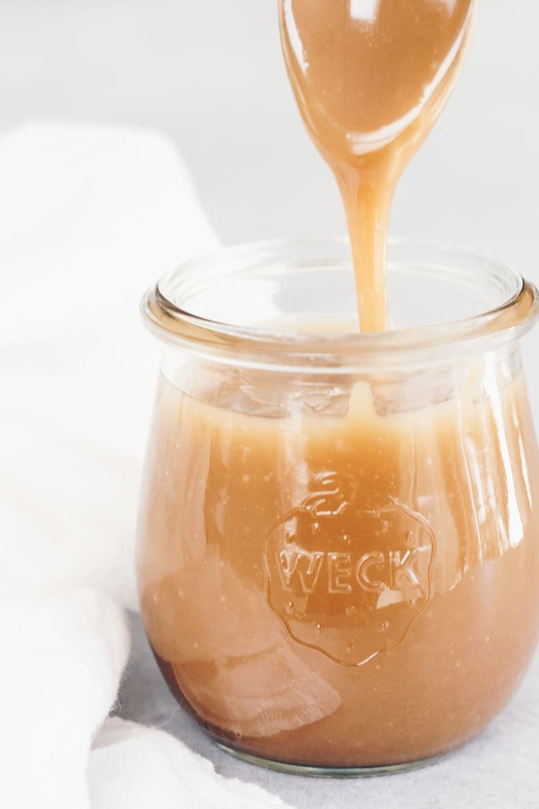 Healthy Paleo Dairy-Free Caramel Sauce Recipe - Spoon with dripping caramel sauce