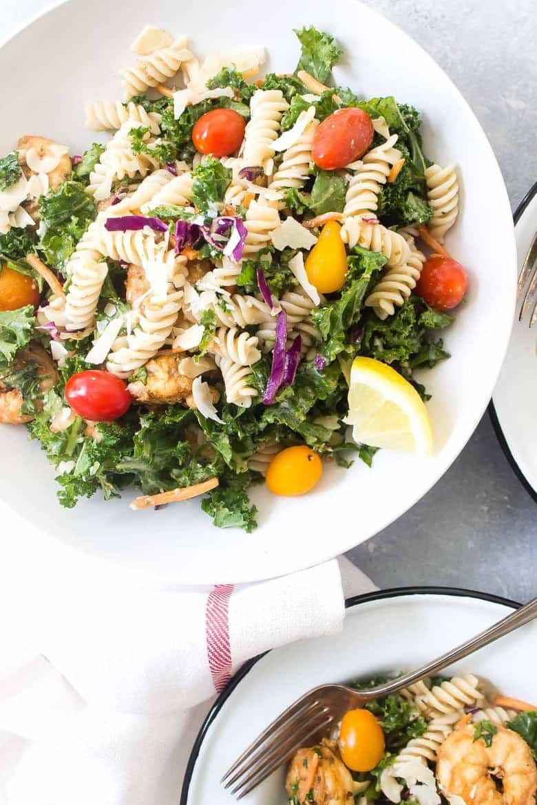 This Caesar Shrimp and Kale Pasta Salad is perfect for batch cooking and can be eaten hot or cold! This is also easily made gluten free!