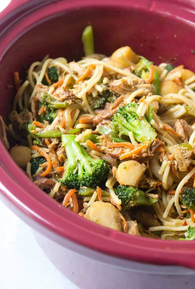 This Gluten Free Lo Mein is made in the slow cooker for an easy dinner! It's packed with chicken, broccoli, water chestnuts, and carrots!