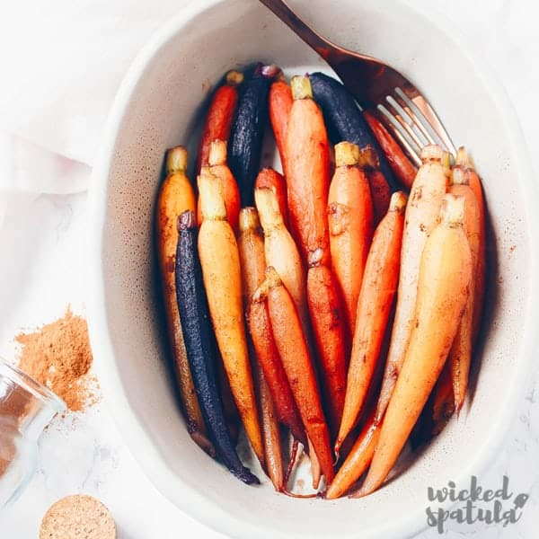 Cinnamon maple glazed carrots in dish