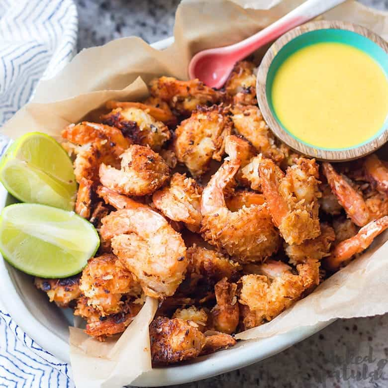Paleo Coconut Shrimp on a platter with dipping sauce