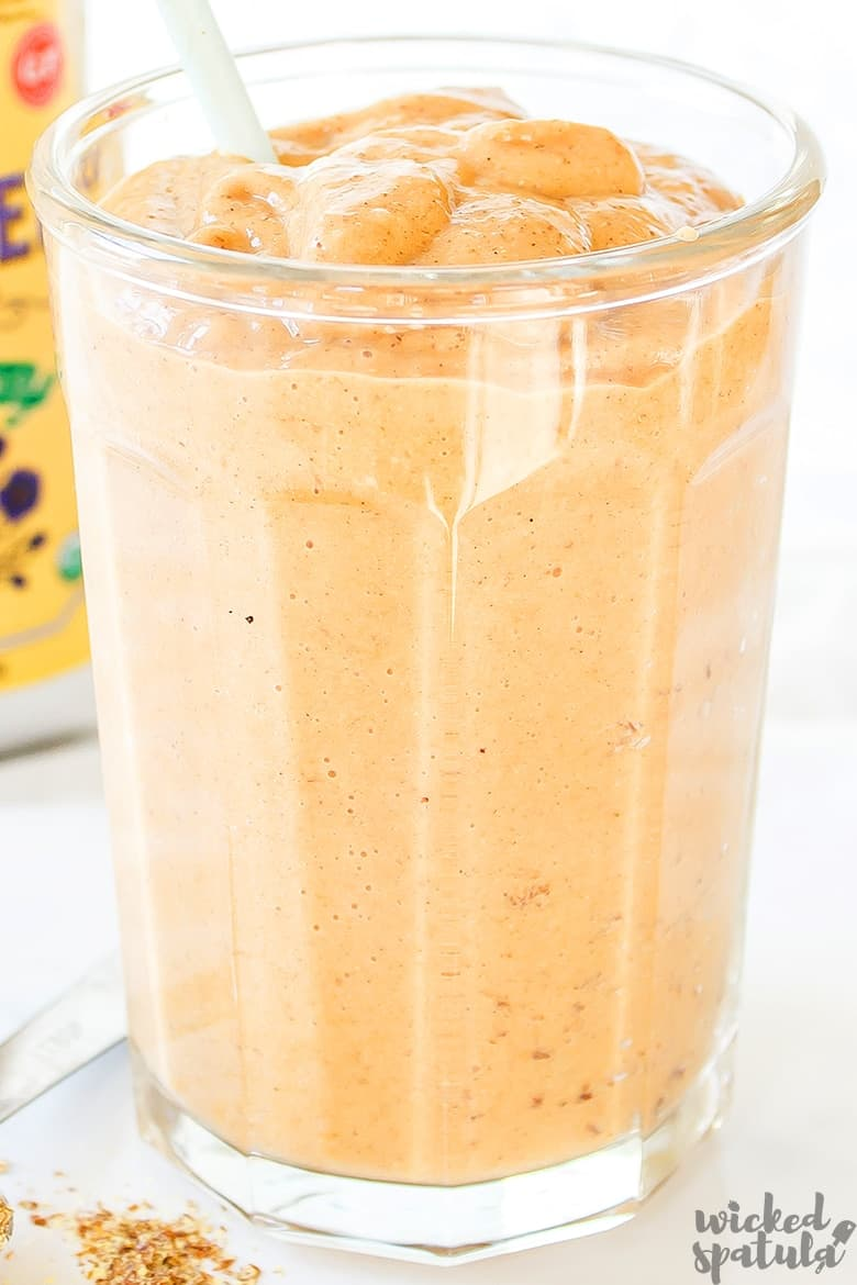 healthy pumpkin smoothie in a glass cup