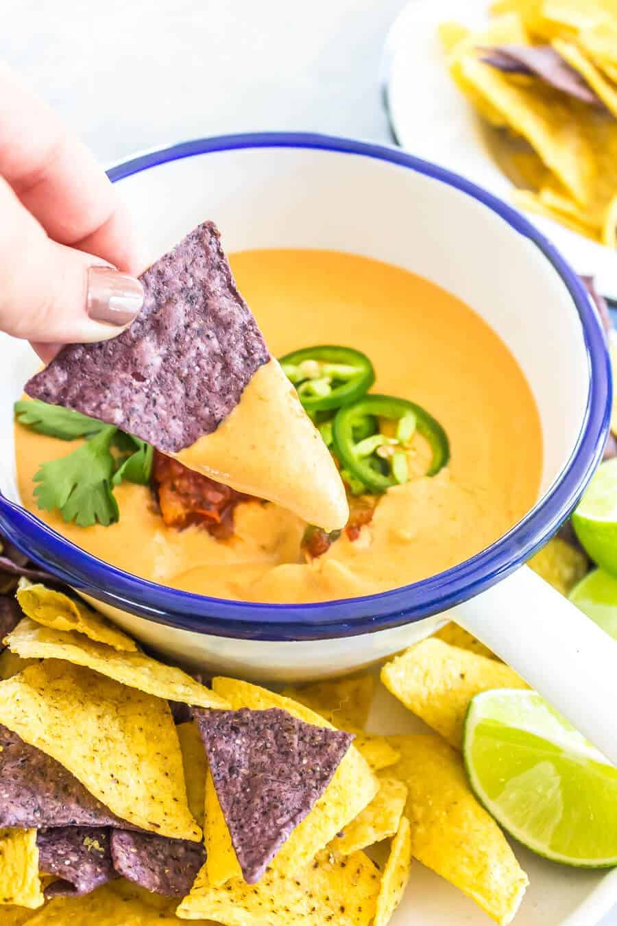 The Best Vegan Queso Recipe - Chip with queso