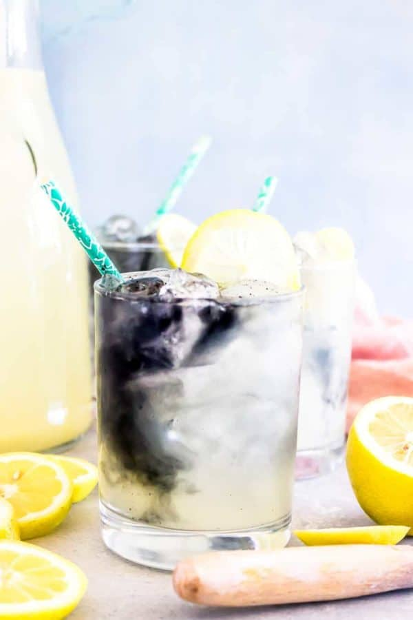 lemonade in a glass with cut lemons
