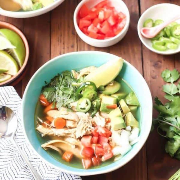 Chicken Caldo de Pollo bowl with toppings