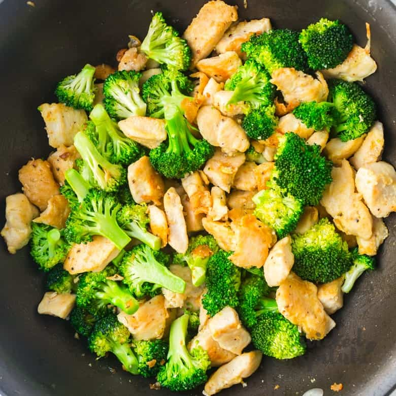 Paleo honey sesame chicken and broccoli in pan