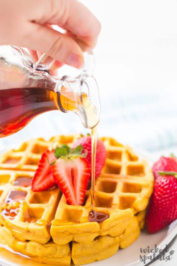syrup being poured over paleo waffles