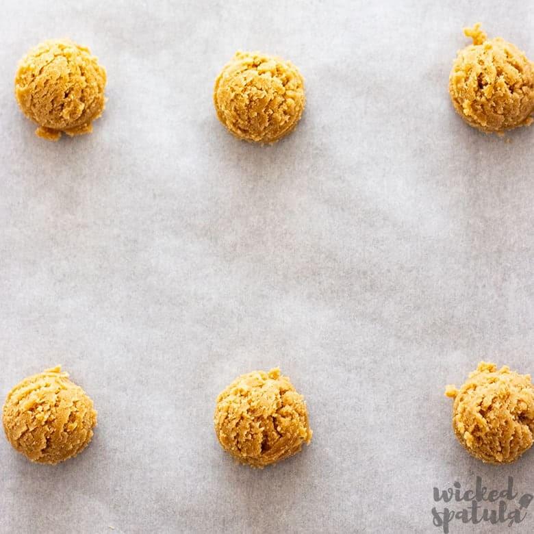 coconut flour sugar cookies in a ball on sheet pan