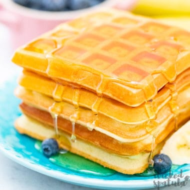 stack of paleo waffles with syrup