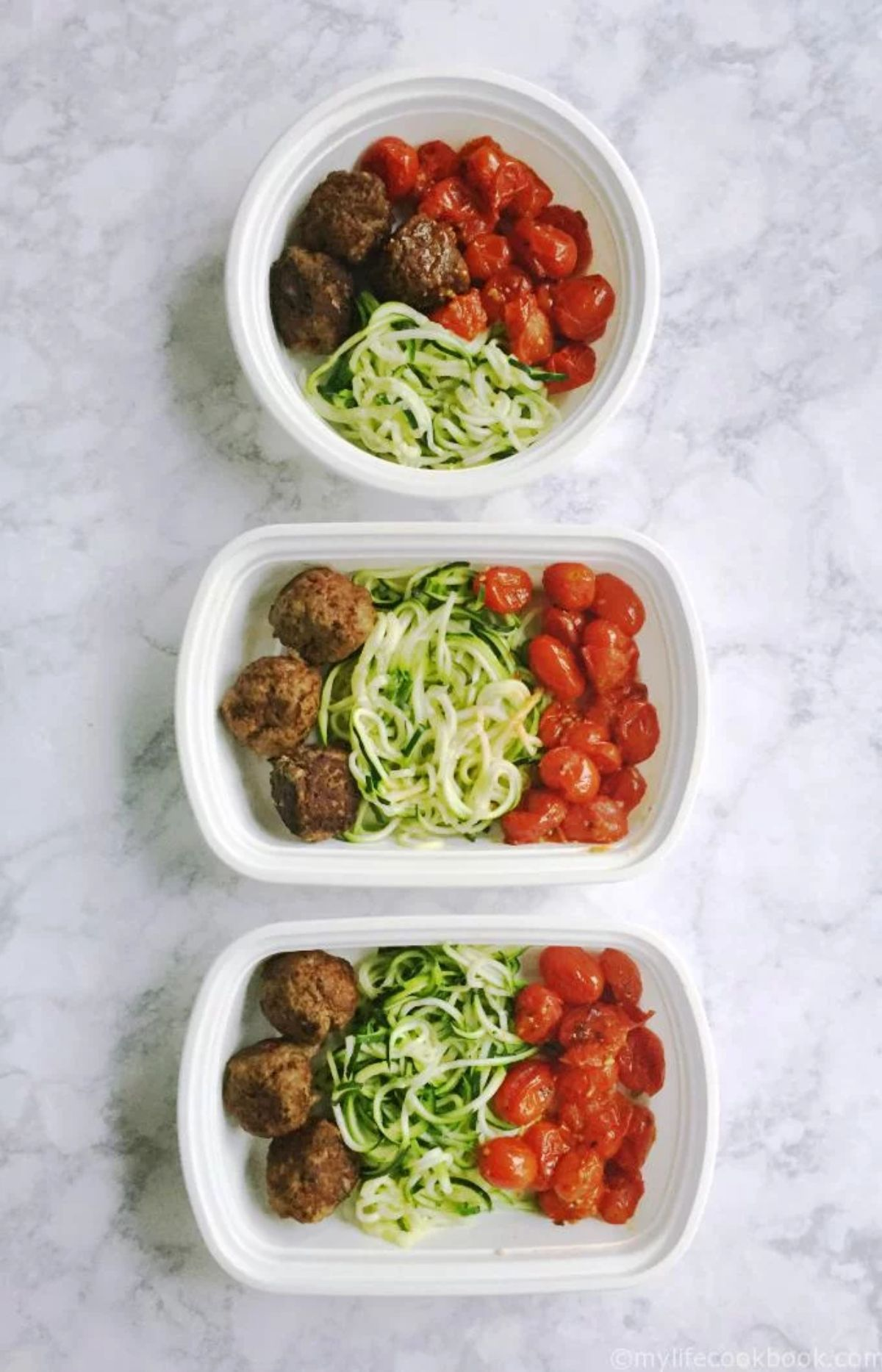 3 containers of meatballs, zoodles and baked plum tomatoes