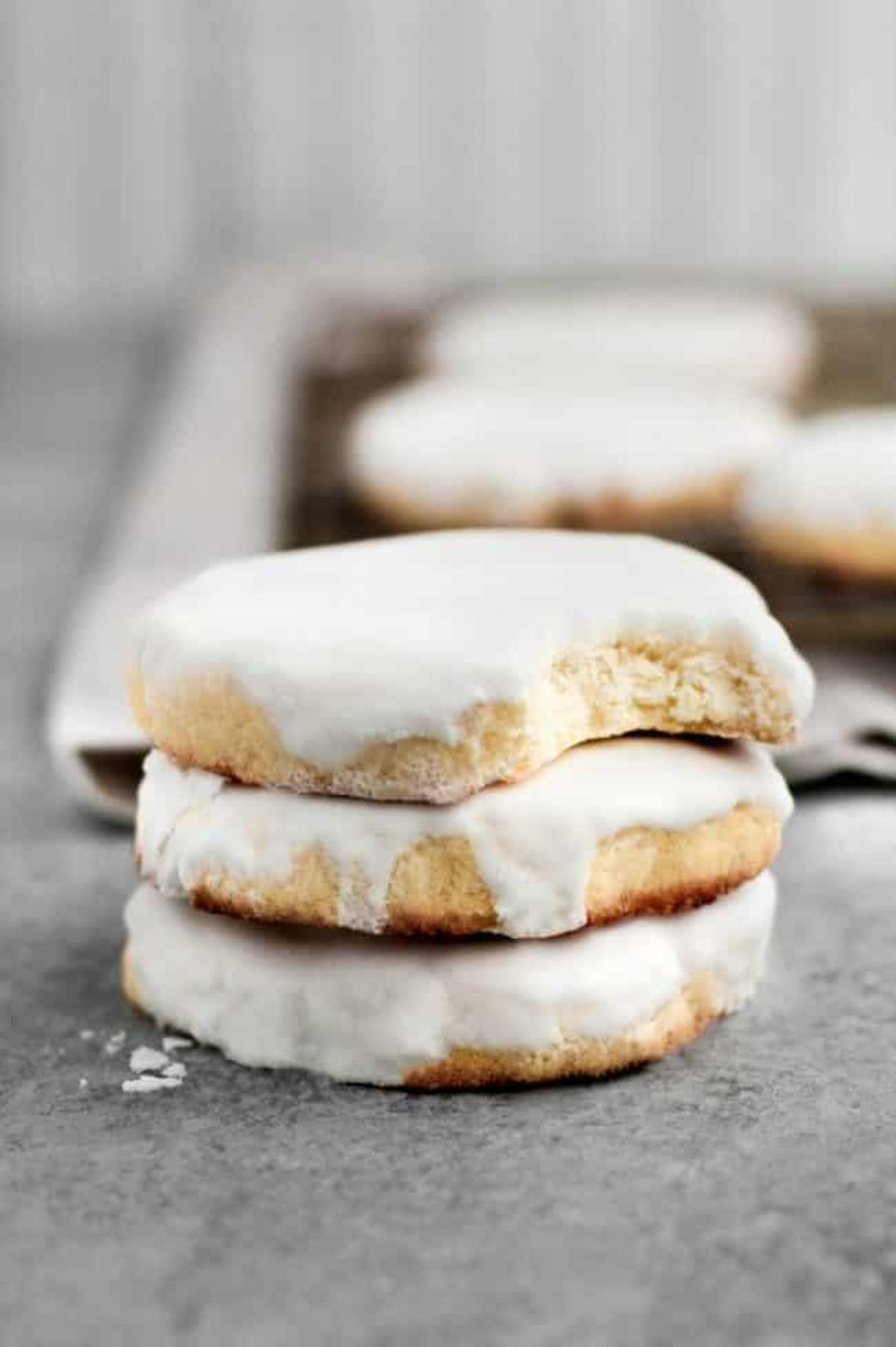 A pile of 3 iced sugar cookies