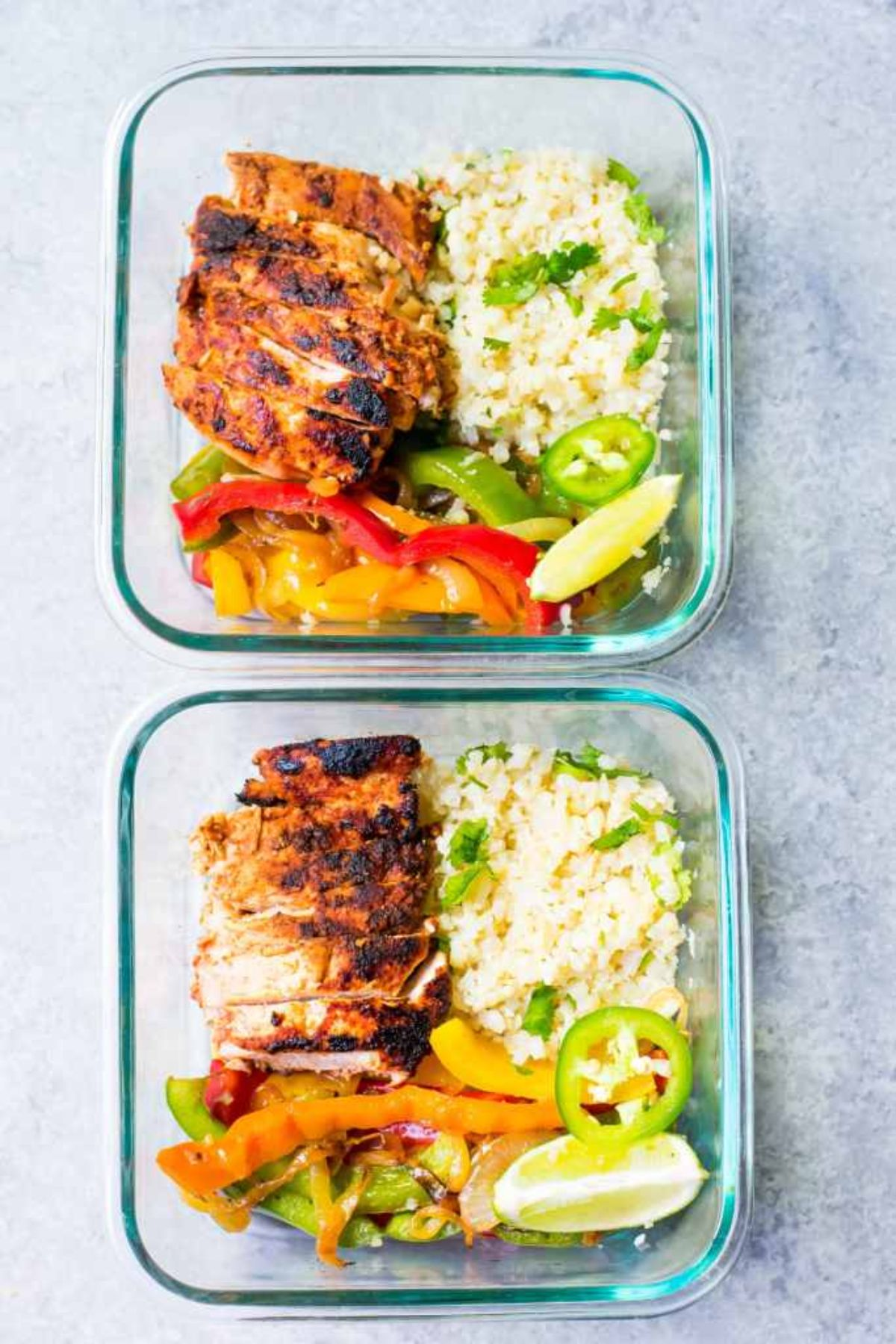 2 glass containers with chicken, cauliflower rice, and stir fried vegetables