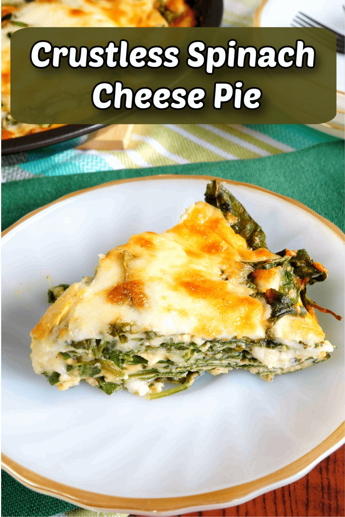 """The text reads """"Crustless Spinach Cheese Pie"""" The photo is of a white plate with a gold rim, on it is a slice of quiche. In the background is a partial shot of teh pan containing the rest of the quiche"""