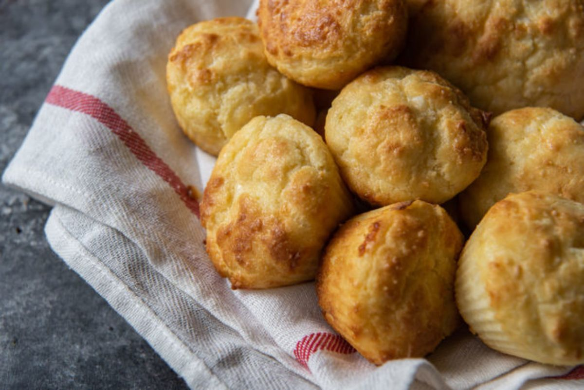 In a cloth lined basket are 8 biscuits